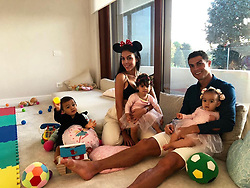 """Cristiano Ronaldo releases a photo on Instagram with the following caption: """"Mis amores \u2764\ufe0f\u2764\ufe0f\u2764\ufe0f\u2764\ufe0f"""". Photo Credit: Instagram *** No USA Distribution *** For Editorial Use Only *** Not to be Published in Books or Photo Books ***  Please note: Fees charged by the agency are for the agency's services only, and do not, nor are they intended to, convey to the user any ownership of Copyright or License in the material. The agency does not claim any ownership including but not limited to Copyright or License in the attached material. By publishing this material you expressly agree to indemnify and to hold the agency and its directors, shareholders and employees harmless from any loss, claims, damages, demands, expenses (including legal fees), or any causes of action or allegation against the agency arising out of or connected in any way with publication of the material."""