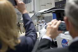 In this photo released by the National Aeronautics and Space Administration (NASA), NASA astronauts Douglas Hurley, left, and Robert Behnken, wearing SpaceX spacesuits, are seen as they depart the Neil A. Armstrong Operations and Checkout Building for Launch Complex 39A to board the SpaceX Crew Dragon spacecraft for the Demo-2 mission launch, Saturday, May 30, 2020, at NASA's Kennedy Space Center in Florida. NASA's SpaceX Demo-2 mission is the first launch with astronauts of the SpaceX Crew Dragon spacecraft and Falcon 9 rocket to the International Space Station as part of the agency's Commercial Crew Program. The test flight serves as an end-to-end demonstration of SpaceX's crew transportation system. Behnken and Hurley are scheduled to launch at 3:22 p.m. EDT on Saturday, May 30, from Launch Complex 39A at the Kennedy Space Center. A new era of human spaceflight is set to begin as American astronauts once again launch on an American rocket from American soil to low-Earth orbit for the first time since the conclusion of the Space Shuttle Program in 2011. Photo Credit: (NASA/Bill Ingalls) Photo by Bill Ingalls / NASA via CNP/ABACAPRESS.COM