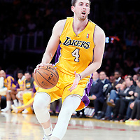 11 April 2014: Los Angeles Lakers forward Ryan Kelly (4) dribbles during the Golden State Warriors 112-95 victory over the Los Angeles Lakers at the Staples Center, Los Angeles, California, USA.