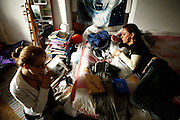 Romana, 28, (left) from Czech Republic, is gazing at her photo album while Daniela, 26, (right) from Romania is helping to pack up her belongings on Saturday, July 21, 2007, in Hampstead, London, England. Romana left the mansion with Lulu, 33, from Romania, her boyfriend, for a two-month holiday in Europe. The 22-room mansion was last sold for UK£ 3.9M in 2002 and is now awaiting planning permissions to be demolished. Two new houses will soon be taking its place. Million Dollar Squatters is a documentary project in the lives of a peculiar group of squatters residing in three multi-million mansions in one of the classiest residential neighbourhoods of London, Hampstead Garden. The squatters' enthusiasm, their constant efforts to look after what has become their home, their ingenuity and adventurous spirit have all inspired me throughout the days and nights spent at their side. Between the fantasy world of exclusive Britain and the reality of squatting in London, I have been a witness to their unique story. While more than 100.000 properties in London still lay empty to this day, squatting provides a valid, and lawful alternative to paying Europe's most expensive rent prices, as well as offering the challenge of an adventurous lifestyle in the capital.