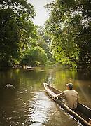 Man Canoeing down the Lekoli River.