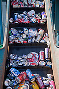 Aluminum cans on conveyer belt ready to be crushed. Recycling Center, Los Angeles, California, USA