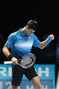 Novak Djokovic wins the first set during the final of the ATP World Tour Finals between Roger Federer of Switzerland and Novak Djokovic at the O2 Arena, London, United Kingdom on 22 November 2015. Photo by Phil Duncan.