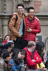 © Licensed to London News Pictures . 23/10/2015 . Manchester , UK . Crowds in Albert Square outside Manchester Town Hall waiting for Chinese president , Xi Jinping , who is visiting Manchester as part of his state visit to the United Kingdom . Photo credit: Joel Goodman/LNP