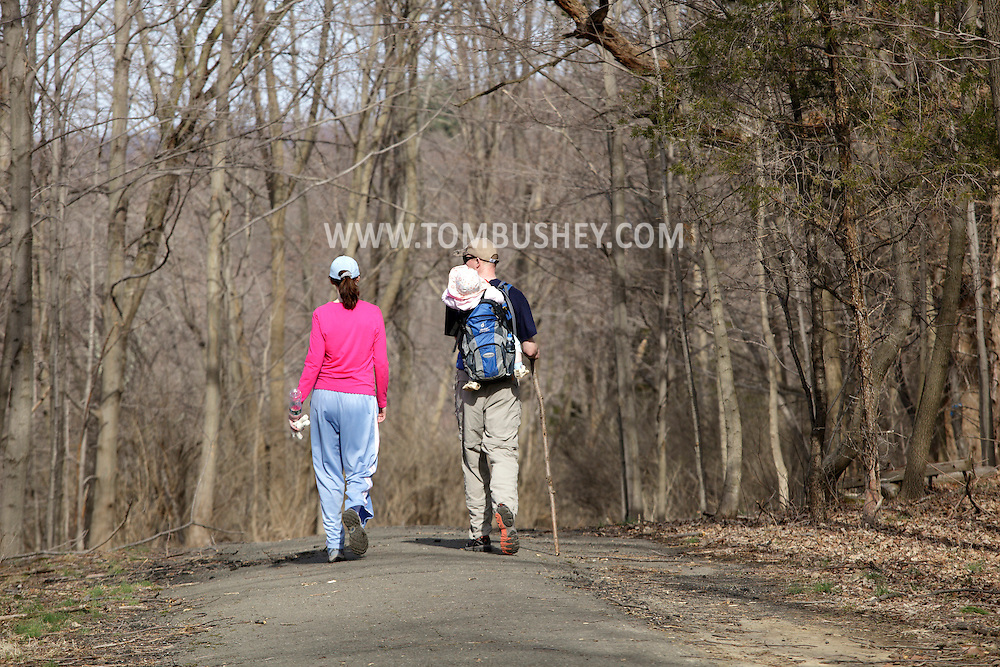 Chester, New York - A couple and their baby hike through Goosepond Mountain State Park on March 20, 2010.