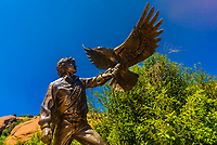"""A bronze sculpture of musician John Denver holding an eagle, titled """"Spirit"""" by Sue DiCicco, Colorado Music Hall of Fame, Red Rocks Trading Post, Red Rocks Park and Amphitheatre, Morrison (near Denver), Colorado USA."""