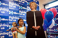 Seven-year-old Violet Phillips poses for a photograph with her American Girl fall and a cardboard cutout of Democratic Presidential candidate Hillary Clinton at the newly-opened Clinton campaign office on Lindell Boulevard in St. Louis Tuesday, Aug. 23, 2016. The office officially opened Tuesday, and Violet was at the event with her mother Rhonda Phillips of St. Louis, who took her daughters photograph.<br /> <br /> Photo by Sid Hastings