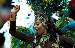 A samba dancer provides pre-match entertainment prior to the match