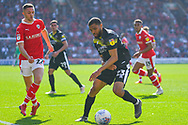 Scott Golbourne of Shrewsbury Town (23) and Jordan Williams of Barnsley (22) in action during the EFL Sky Bet League 1 match between Barnsley and Shrewsbury Town at Oakwell, Barnsley, England on 19 April 2019.