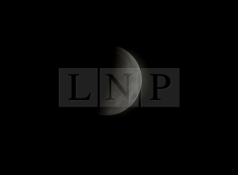 © under license to London News Pictures.  The moon passes through the Earth's shadow as seen from New Paltz, New York, USA. Photo credit should read Michael Graae/London News Pictures
