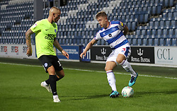 Peterborough's Joe Ward (left) and Queens Park Rangers' Jake Bidwell battle for the ball during the Carabao Cup, First Round match at Loftus Road, London.