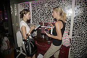 Nadia Brooks and Sarah-Jane Horner, Book launch of 'Fashion Babylon' by Imogen Edwards-Jones and Anonymous. 43 South Molton St. London. 19 July 2006. ONE TIME USE ONLY - DO NOT ARCHIVE  © Copyright Photograph by Dafydd Jones 66 Stockwell Park Rd. London SW9 0DA Tel 020 7733 0108 www.dafjones.com