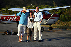 05 April 2011. St Maarten, Antilles, Caribbean.<br /> Sunday Telegraph reporter David Harrison (rt), Trisha Baily (wife of David Hildred) and pilot Eric Jompnier step from a 1962 Cessna used to cover Antiki Raft.<br /> After more than 9 weeks at sea, having started in the Canary islands, the 'Antiki' transatlantic raft gets set to arrive in St Maarten in the Caribbean following an epic voyage. The incredible vessel is crewed by Anthony Smith (84 yrs old) British adventurer, David Hildred, sailing master and British Virgin Islands resident, Dr Andrew Bainbridge of Alberta, Canada and John Russell, solicitor and UK resident.<br /> Photo; Charlie Varley/varleypix.com