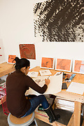 Artist Shivangi Ladha at work in the  workshop area of The International Print Center. The workshop can be viewed by the public.