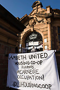 Protest banner outside Carnegie Library in Herne Hill, south London while occupiers remain inside the premises on day 6 of its occupation, 5th April 2016. The angry local community in the south London borough have occupied their important resource for learning and social hub for the weekend. After a long campaign by locals, Lambeth have gone ahead and closed the library's doors for the last time because they say, cuts to their budget mean millions must be saved.
