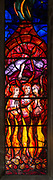 Detail of stained glass window Benjamin Britten memorial by John Piper, Aldeburgh, Suffolk, England, UK - burning fiery furnace