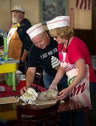 """John and Rae Fleming of Santa Cruz, Calif. ready their """"Spamoni"""" ice cream for the judges at the 22nd annual Spam Festival, Sunday, Feb. 16, 2019, in Isleton, Calif. Spam lovers competed for prizes by presenting their favorite Spam-infused foods, or entering the Spam-eating and Spam-toss contests. (Photo by D. Ross Cameron)"""