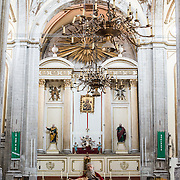 The main altar of Iglesia de la Santisima Trinidad in Mexico City, Mexico. Iglesia de la Santisima Trinidad translates as Church of the Holy Trinity.