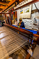 Woman operates a loom in the Mercedes Workshop in the villaage of Pampaneira, Sierra Nevada National Park, Granada Province, Andalusia, Spain.