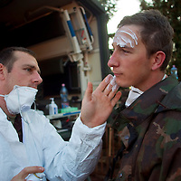 Military doctors treat soldiers' injuries caused by chemical rections during waste disposal wors. Devecser in Hungary's Veszprem county has been flooded by toxic sludge released by a dam accident in a nearby container. The toxic chemicals left its red marking on all the walls of the houses in and out and covered all moveable belongings and streets killing people and animals. Red sludge is a waste from bauxite fefining that has a strong caustic effect. The toxic flood covered an area of over 800-1,000 hectares (1,920-2,400 acres). Seven people were killed and more than 150 injured in the disaster. Pollution from the red sludge now spread into the local rivers killing all life in rivers Marcal and Torna and now it mixed into the main European waterway river Danube. Officials say there is no risk of a biological or enviromental catastrophe there.  Devecscer, Hungary, Saturday, 09. October 2010. ATTILA VOLGYI