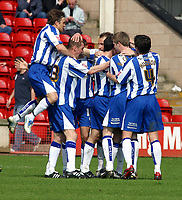 Photo: Dave Linney.<br />Walsall v Huddersfield Town. Coca Cola League 1. 22/04/2006.Huddersfield players celebrate afterDavid Graham made it 1-0