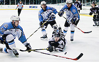 Tri-City Storm's Conner Valesano (16) dives for the puck as Lincoln Stars' Tye Ausmus, left, Biagio Lerario (26) and Paatrick Polino (27) defend during Tuesday's game at the Viaero Event Center in Kearney. The Tri-City Storm defeated the Lincoln Stars 6-1. (Independent/Matt Dixon)