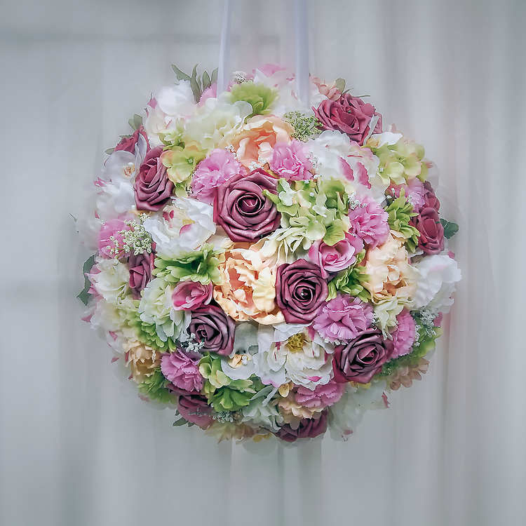 A beautiful flower bouquet against a sheer white backdrop.