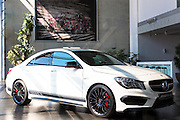Mercedes-AMG CLA 45 AMG with latest 4 cylinder engine and cereamic brakes in showroom at engine factory in Affalterbach, Germany