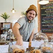 Tucson, AZ -- 09/29/2017<br /> <br /> 5 Points Market & Restaurant sits at the main junction at Five Points, which brings five Tucson neighborhoods together. The popular breakfast, coffee shop and small market offers fresh baked goods and menu items ranging from hearty to healthy.<br /> <br /> 5 points barista Adan Martinez-Kee selects baked goods for customers at the bar.<br /> <br /> <br /> Photography by Jill Richards