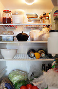 open fridge with food and drinks content