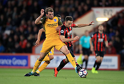 Brighton & Hove Albion's Dale Stephens (left) and AFC Bournemouth's Marc Pugh battle for the ball during the Premier League match at the Vitality Stadium, Bournemouth.