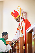 Led by Bishop Emmanuel Makala, pastoral candidate Lucas Mwigulu is ordained in a service with more than 1,000 worshippers on Sunday, March 15, 2015, at the Evangelical Lutheran Church in Tanzania – South-East of Lake Victoria Diocese's (ELCT-SELVD) Ebenezer Cathedral in Shinyanga, Tanzania. LCMS Communications/Erik M. Lunsford