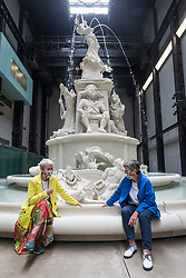 "© Licensed to London News Pictures. 24/07/2020. LONDON, UK. Maria Balshaw (L), Director Tate, and Frances Morris, Director Tate Modern, wearing facemasks pose next to ""Fons Americanus"", 2019, by Kara Walker. Press preview ahead of the reopening of Tate Modern on 27 July after the easing of coronavirus pandemic lockdown restrictions by the UK government.  Visitors will need to book timed tickets online and follow one-way routes around the gallery space along with observing social distancing rules.  Photo credit: Stephen Chung/LNP"