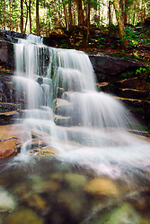Cool, clear water spills from the White Mountains at Stairs Falls in New Hampshire.