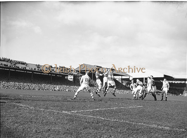 Three players all jump to catch the ball near the Kerry goalmouth during the All Ireland Senior Gaelic Football Final Kerry v Dublin in Croke Park on the 25th September 1955. Kerry 00-12 Dublin 01-06.