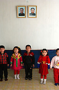 North Korea:.North Hwanghae Province..Children sing songs about the Great Leader and Dear Leader at a nursery in Yonsan, Yonsan county. ...(C)Jeremy Horner.15 Mar 2004Pyongyang, North Korea, DPRK