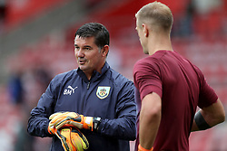 """Burnley goalkeepers Joe Hart (right) with goalkeeping coach Billy Mercer before the Premier League match at St Mary's, Southampton. PRESS ASSOCIATION Photo. Picture date: Sunday August 12, 2018. See PA story SOCCER Southampton. Photo credit should read: Andrew Matthews/PA Wire. RESTRICTIONS: EDITORIAL USE ONLY No use with unauthorised audio, video, data, fixture lists, club/league logos or """"live"""" services. Online in-match use limited to 120 images, no video emulation. No use in betting, games or single club/league/player publications."""