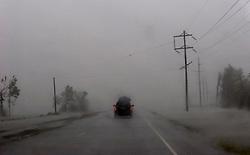 24 Sept, 2005. Louisiana/Texas border. Hurricane Rita aftermath. <br /> <br /> Route 27, Louisiana where the storm hit hardest on the Louisiana/Texas border. The back edge of Rita floods across the roadway.<br /> Photo; ©Charlie Varley/varleypix.com