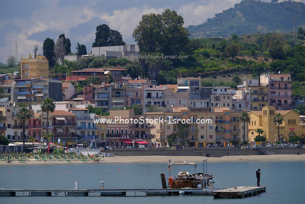 Yachts and boats in the resort of Giardini Naxos bay, Taormina, Sicily, Italy
