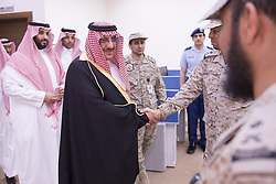 File photo - Saudi Arabia's Deputy Crown Prince and interior minister Prince Mohammad bin Nayef (center) and Defense Minister Prince Mohammed bin Salman bin Abdelaziz Al Saud (L) seen leading the operation Decisive Stormair campaign, launched against Houthi militants in Yemen, from the main command centre in Riyadh, Saudi Arabia, on March 26, 2015. Saudi Arabia's king has appointed his son Mohammed bin Salman as crown prince - replacing his nephew, Mohammed bin Nayef, as first in line to the throne. Prince Mohammed bin Nayef, 57, has been removed from his role as head of domestic security, state media say. Photo by Balkis Press/ABACA.