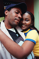 Young man and woman hugging,