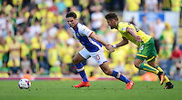 Blackburn Rovers' Ben Marshall shields the ball from Norwich City's Ivo Pinto<br /> <br /> Photographer Chris Vaughan/CameraSport<br /> <br /> Football - The EFL Sky Bet Championship - Blackburn Rovers v Norwich City - Saturday 6th August 2016 - Ewood Park - Blackburn<br /> <br /> World Copyright © 2016 CameraSport. All rights reserved. 43 Linden Ave. Countesthorpe. Leicester. England. LE8 5PG - Tel: +44 (0) 116 277 4147 - admin@camerasport.com - www.camerasport.com
