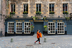 Edinburgh, Scotland, UK. 17 October 2020. Saturday afternoon in Edinburgh city centre during 16 day short circuit lockdown and bars are closed but cafes remain open. Streets in the Old town are very quiet and reminiscent of the eerie emptiness seen during the full lockdown earlier this year. The Beehive Inn is closed in The Grassmarket. Iain Masterton/Alamy Live News