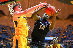 Feb 18, 2019; Morgantown, WV, USA; Kansas State Wildcats forward Makol Mawien (14) and West Virginia Mountaineers forward Logan Routt (31) jump for a rebound during the first half at WVU Coliseum. Mandatory Credit: Ben Queen-USA TODAY Sports
