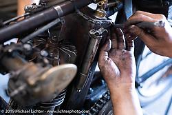 Niimi (Yoshimasa Niimi) working on Shinya Kimura's 1915 Indian that he and Shinya will ride cross country in the September 2018 Cannonball-V. Chabott Engineering, Azusa, CA. USA. Wednesday June 27, 2018. Photography ©2018 Michael Lichter.