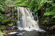 East Gill Waterfall, Keld, in Yorkshire Dales National Park, United Kingdom, Europe. England Coast to Coast hike with Wilderness Travel, day 8 of 14: Keld to Reeth. We followed the River Swale via meadows, woods, and villages. Overnight at Kings Head Hotel in Richmond, North Yorkshire county. [This image, commissioned by Wilderness Travel, is not available to any other agency providing group travel in the UK, but may otherwise be licensable from Tom Dempsey – please inquire at PhotoSeek.com.]