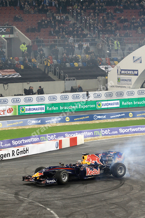 Sebastian Vettel doing donuts in his Red Bull-Renault before  the 2010 Race of Champions at the Esprit Arena in Dusseldorf. Photo: Grand Prix Photo/ Michael Stirnberg