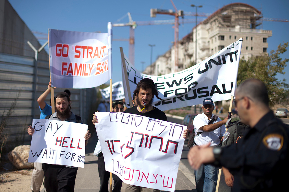 Ultra-Orthodox Jewish men hold banners opposing the gay pride parade, as they march during what they call a 'beast parade' held in Jerusalem, on July 28, 2011. The anti gay pride parade is part of the protest parades against the mass event held by the gay-lesbian community nearby at the same time.
