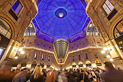 People stroll through Galleria Vittorio Emmanuele II, the centre of luxury shopping in central Milan, on 6th December 2008 in Milan, Italy. The Galleria, lit up here for Christmas, is known affectionately as the living room of Milan because of its popularity as a meeting place, and hosts the original Prada store.