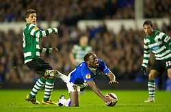 LIVERPOOL, ENGLAND - Tuesday, February 16, 2010: Everton's captain Steven Gerrard MBE is brought down by Sporting Clube de Portugal's Daniel Carrico during the UEFA Europa League Round of 32 1st Leg match at Goodison Park. (Photo by: David Rawcliffe/Propaganda)